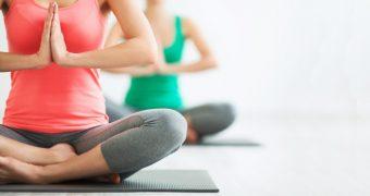 Beneficiile aduse de Yoga